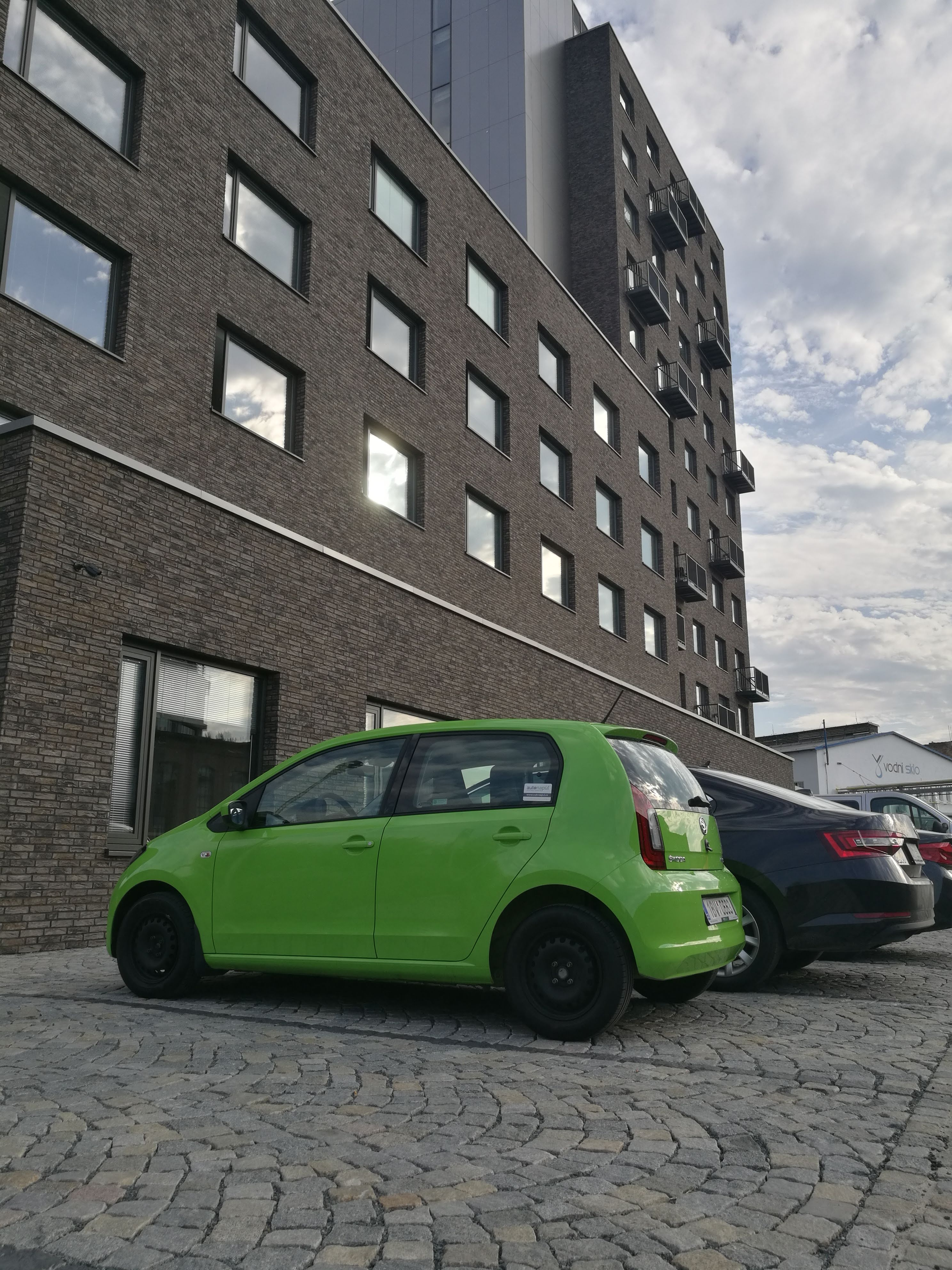Skoda Citigo Kodos next to the Foreigners.cz's apartment building called Domeq